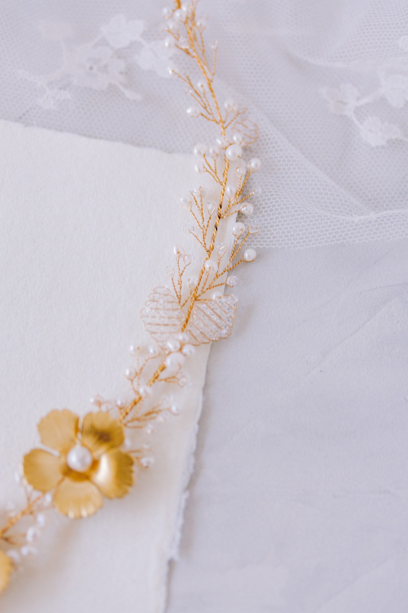 Bespoke bridal headpiece hairjewellery with golden flowers with tiny sparkling crystals and high-quality freshwater pearls.